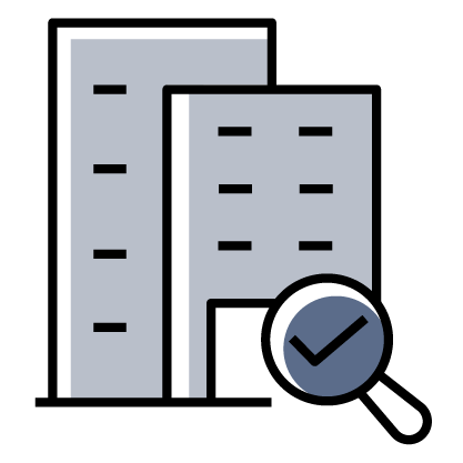 Buildings with magnify glass icon